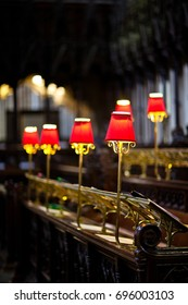 Choir pews with red lamps in a cathedral