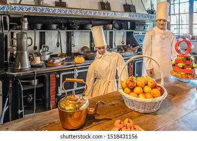 CHOISEL, FRANCE - SEPTEMBER 23, 2019. Breteuil castle. The kitchen, and a large collection of original utensils. Wax models made by the Musée Grévin in Paris reproduce everyday life.