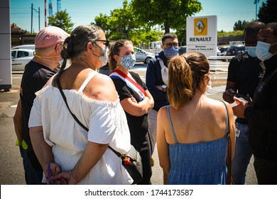 CHOISY LE ROI - FRANCE -29 MAY 2020: union delegates from the renault de choisy le roi factory talking to a elected municipal official after an announcement of plant closure linked to a social plan
