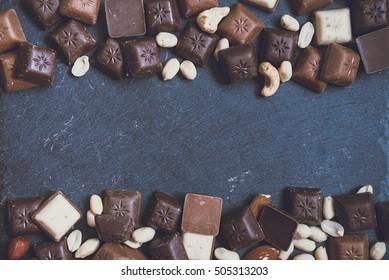chokolate on granite background, view on top