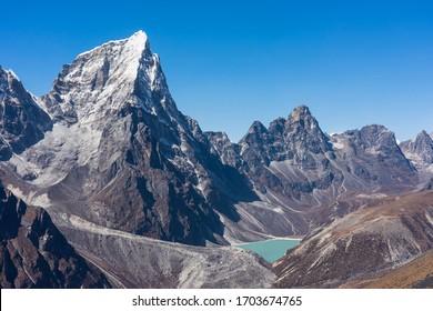 Cholatse mountain peak and small lake at base, Everest base camp trekking in Himalaya mountains range, Nepal, Asia