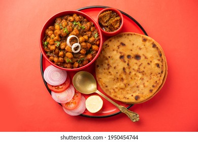 Chole with Aloo Paratha or Alu parantha, popular north Indian food recipe served hot with mango pickle