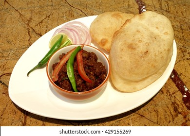 CHOLE BHATURE is one of the most popular food in Northern India. Chole stands for a spicy curry made with spicy white chick peas and bhatura is fried leavened flat fluffy deep-fried leavened bread.
