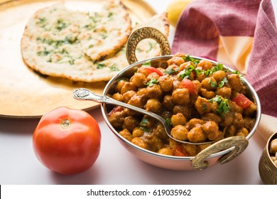 Chole or Chana Masala or Spicy Chickpeas is traditional North Indian main course recipe and usually served with Bhatura or Roti/ Naan. Selective focus