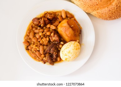 Cholent  or hamin (Hebrew‬) is a traditional Jewish stew, cooking on Friday before the Sabbath begins and kept on hot plate until the following day.Cholent main ingredients: meat, beans, barley,eggs.