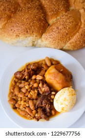 Cholent  or hamin (Hebrew) is a traditional Jewish stew,  cooking on Friday before the Sabbath begins and kept on hot plate until the following day.Cholent main ingredients: meat, beans, barley,eggs.