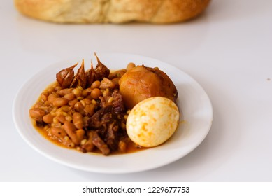 Cholent: The Sabbath Stew Prepared Friday and slow-cooked overnight, cholent is the traditional Sabbath-day dish served with challah .