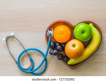 Cholesterol diet and healthy food nutritional for cardiovascular disease prevention concept with clean fruits with antioxidant in heart dish with nutritionist and doctor monitoring conceptual idea