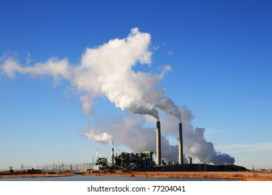 Cholla coal fired electric power plant in Arizona with white steam clouds and blue sky