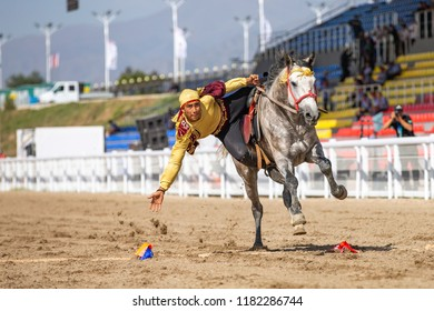 Cholpon-Ata, Kyrgyzstan, 7th September 2018: man riding on a horse for a game of Tyiyn enmei during World Nomad Games 2018