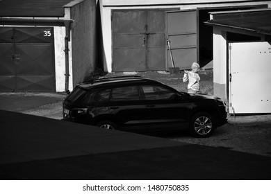 Chomutov, Czech republic - August 16, 2019: new car Skoda between garages at sommer evening