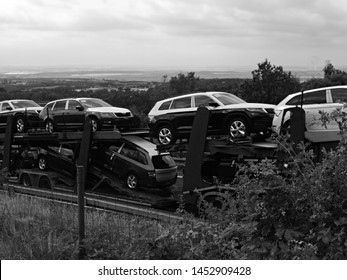 Chomutov, Czech republic - July 15, 2019: cars on moving camion on highway D7 leading to Germany