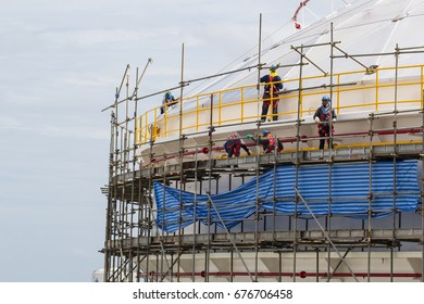 Chon Buri Thailand - July 12th, 2017: Construction workers installing scaffolding storage tank.