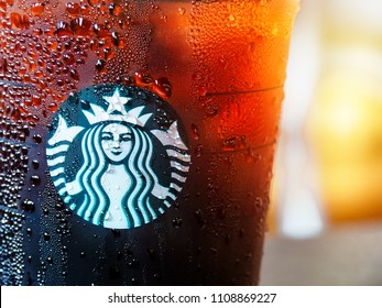 Chon Buri, Thailand - June 09, 2018: : Starbucks coffee brand logo on cold brew beverage cup. Starbucks is the world's largest coffee house with over 20,000 stores in 61 countries.