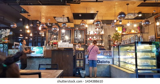Chon Buri/ Thailand - June 2019: A female customer buys a soft drink in a modern cafe.