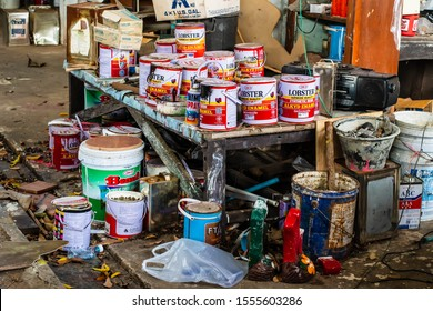 CHON BURI, THAILAND - NOVEMBER 4, 2019: Dirty paint cans of the woodworker after the using.The garbage from cans painted after the use of woodworkers.