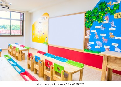 CHON BURI, THAILAND - SEPTEMBER 25, 2019: Desks, chairs and white board in the kindergarten classroom at Wattananusas school, Thailand.