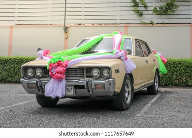 Chon Buri Thailand-JUNE-17-2018;DATSUN 260C SALOON for the wedding ceremony and Decorate colourful ribbon on front and top and rear with car at Parking St. Nikolaus Church, Pattaya