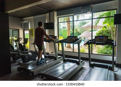 Chon Burii, Thailand - October, 05, 2019  : Unidentified name asian man in sportswear running on treadmill at gym in the tide hotel at Chon Burii, Thailand. Running fast.