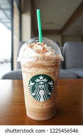 Chon buri,Thailand/Chon buri  October 26, 2018 : Starbucks coffee Mocha frappe  on wood table in Starbucks coffee shop.