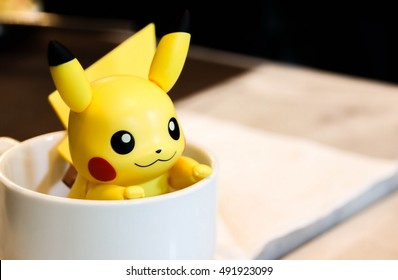 CHONBURI - AUG 14, 2016 : Pikachu figure from Pokemon anime in coffee cup on Aug 14, 2016 at Chonburi, Thailand.