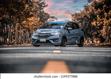 CHONBURI - July 14: Gray Car Honda Jazz GK racing car parked on the street. Stock photography Space for text. Background with car. July 14, 2018 in Chonburi, Thailand
