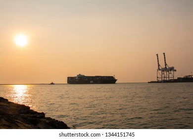 CHONBURI, TH - MARCH 16, 2019: Photo of APL ship, Travleing from Laem Chabang Port,Container full container, Sunset Backlit photography