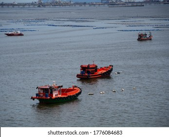 Chonburi Thailand, 09/07/2020, Two orange fishing boats mooring in the sea During the day after night fishing