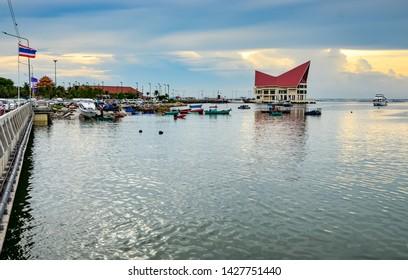 CHONBURI, THAILAND - 1 JUNE : Sriracha port with sunset sky on 1 June 2019 in Sriracha, Chonburi, Thailand