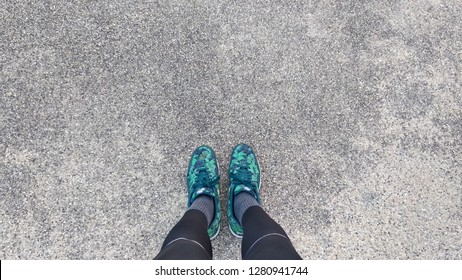 CHONBURI, THAILAND - 11 JAN : Sport shoes with sand concrete floor background on 11 January 2019 in Sriracha, Chonburi, Thailand