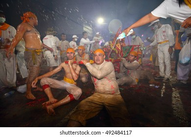 CHONBURI, THAILAND - 2016, October 2 : At night, The parade possessed by his god, so tried after walking on fire in Vegetarian Festival also known as Nine Emperor Gods Festival.