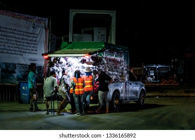 CHONBURI, THAILAND - 4 DEC : Construction worker buy food with market truck at night on 4 December 2017 in Sriracha, Chonburi, Thailand