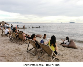 Chonburi / Thailand - 5 September 2020: Many tourists sit on the sand and enjoy the sea view inside the Seafood Club restaurant in Chonburi, Thailand.