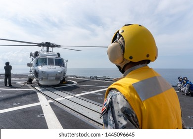 CHONBURI, THAILAND - APRIL 10, 2019:  Sikorsky MH-60S Seahawk helicopter is chalked and chained on the flight deck of the HTMS. Bhumibol Adulyadej stealth frigate of Royal Thai navy.