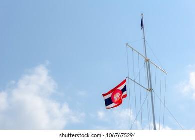 CHONBURI, THAILAND - APRIL 11, 2018 : Royal Thai Navy ensign blow on gaff navy style flag pole on April 11, 2018 in Chonburi, Thailand.