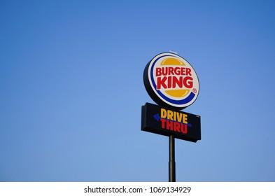 Chonburi, Thailand - April 14, 2018 : Burger King Drive Thru Outdoor Billboard against blue sky. Burger King is a global chain of hamburger fast food restaurants