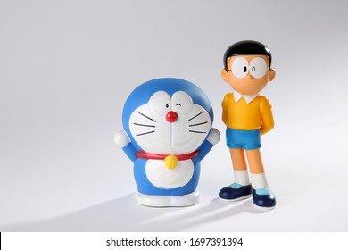 CHONBURI, THAILAND, APRIL 8, 2020 : Soft focus on Cartoon model (Doraemon and Nobita) on white background, Doraemon is an all time famous TV cartoon
