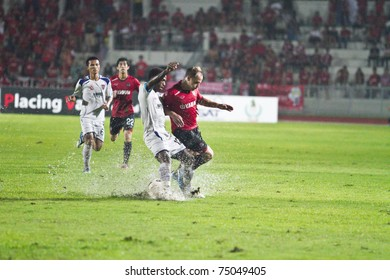 CHONBURI THAILAND - APRIL 9: M.Toth(R) in action at Thai Premier League (TPL) between MTutd (red) vs Siamnavy fc (white)  on April 9, 2011 at institute of physical education, Chonburi, Thailand