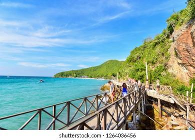 Chonburi, Thailand - December 15, 2018: Wooden Bridge at Tien Beach on Koh Larn Island