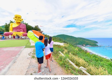 Chonburi, Thailand - December 15, 2018: Golden Monk Statue and the View Point on Tropical Island of Koh Larn in Pattaya