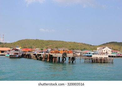Chonburi, Thailand - February 11, 2012: Na Ban Pier is the first gate welcoming tourists to Koh Larn, a popular island for water activities.