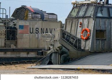 CHONBURI, THAILAND - FEBRUARY 17, 2018: US Marine vehicle personel check the ramp cable of Landing Craft Air Cushion or LCAC after landed on the beach on February 17,2018 in Chonburi.
