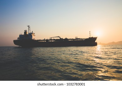 CHONBURI, THAILAND, FEBRUARY 2017: Unidentified Cargo Ship sailing on sea and People working on ship as safety