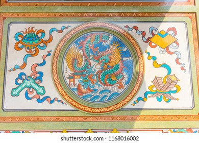 Chonburi, Thailand - February 28, 2018 : Old mural wall picture depicting dragon and pheonix in Naja Chinese shrine in Chonburi, Thailand on February 28, 2018.