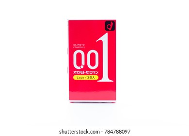 CHONBURI - THAILAND - JANUARY 2, 2018: Box of condom size 0.001 mm. or 1 micron on Isolated white background.  OKAMOTO CONDOMS BRAND. L SIZE. 3 Pieces with 1 Box. Import From JAPAN.