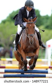 CHONBURI, THAILAND - JULY 28:Negishi Atsushi of Japan with Rata 21 in action during 1st FEI Asian Eventing Championships 2013 at Thai Polo&Equestrian Club on July 28, 2013 in Chonburi, Thailand.