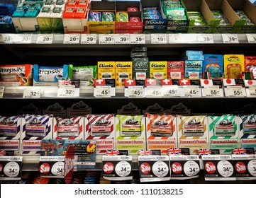 Chonburi THAILAND June 11, 2018: Hands of people are choosing Lozenge to hold goods to buy. stacked on a shelf in a supermarket.