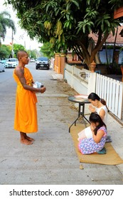 CHONBURI - THAILAND , MAR 13 - 2016 : Thailand's popular morning alms give food to monk. The Buddhist clergy as religious beliefs.