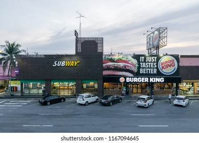 Chonburi , Thailand – May 07 2018 : People stop car in the car parked at the restaurant subway, burgerking, starbucks, mcdonalds and toilet in motor way center in thalland. rest for the car.