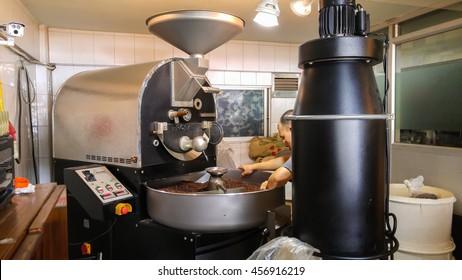 Chonburi, Thailand - May 18, 2016 - roast master works on roaster machine